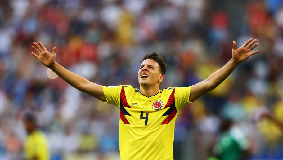 SAMARA, RUSSIA - JUNE 28:  Santiago Arias of Colombia celebrates victory after winning the 2018 FIFA World Cup Russia group H match between Senegal and Colombia at Samara Arena on June 28, 2018 in Samara, Russia.  (Photo by Dean Mouhtaropoulos/Getty Images)