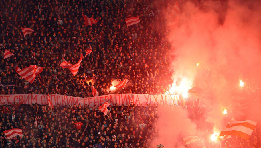 Supporters of FC Red Star Belgrade (FK Crvena zvezda) display a banner reading, 'In honour to all Serbian generals in the Hague' during a derby soccer match between Red Star and Partizan at the Marakana stadium in Belgrade, on November 17, 2012. A dramatic acquittal of former generals Ante Gotovina and Mladen Markac by the International Criminal Tribunal for the former Yugoslavia (ICTY) on November 16 provoked anger in Serbia.   AFP PHOTO / ANDREJ ISAKOVIC        (Photo credit should read ANDREJ ISAKOVIC/AFP/Getty Images)