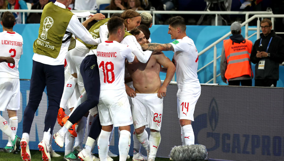 KALININGRAD, RUSSIA - JUNE 22:  Xherdan Shaqiri of Switzerland celebrates with teammates after scoring his team's second goal during the 2018 FIFA World Cup Russia group E match between Serbia and Switzerland at Kaliningrad Stadium on June 22, 2018 in Kaliningrad, Russia.  (Photo by Clive Rose/Getty Images)
