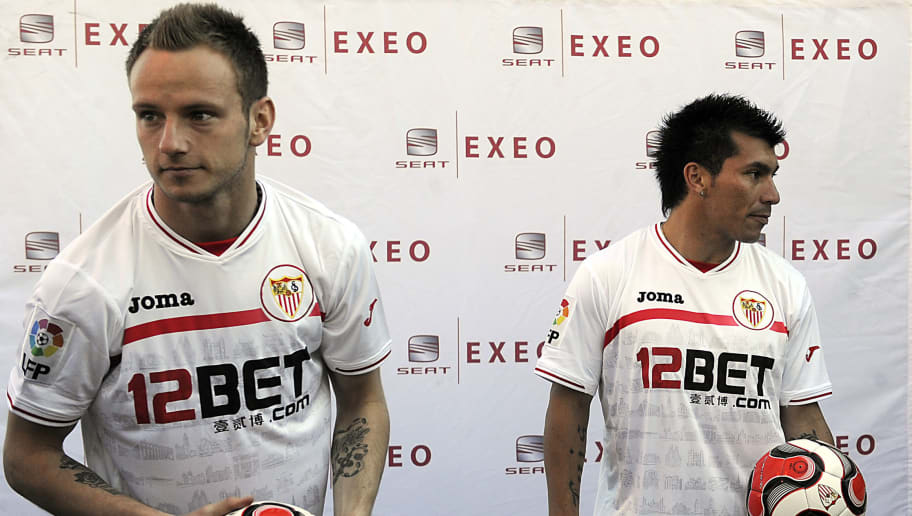 Sevila FC's new signing football players, Chilean midfielder Gary Medel (R) and Croatian-Swiss midfielder Ivan Rakitic (L) pose during their presentation to the media on January 31, 2011 in Sevilla.    AFP PHOTO/ CRISTINA QUICLER  (Photo credit should read CRISTINA QUICLER/AFP/Getty Images)