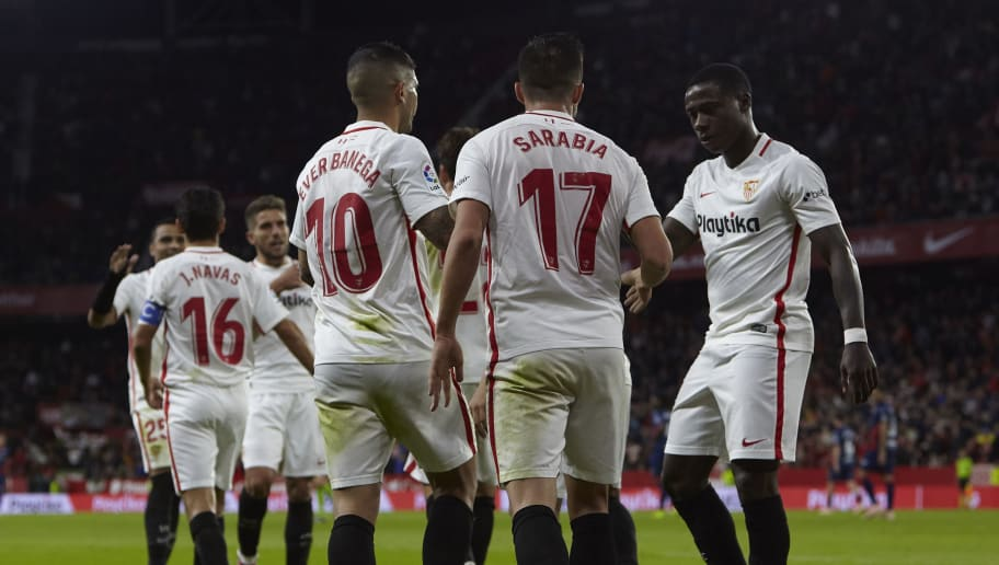 SEVILLE, SPAIN - OCTOBER 28:  Players of Sevilla celebrates the team's opening goal during the La Liga match between Sevilla FC and SD Huesca at Estadio Ramon Sanchez Pizjuan on October 28, 2018 in Seville, Spain.  (Photo by Quality Sport Images/Getty Images)