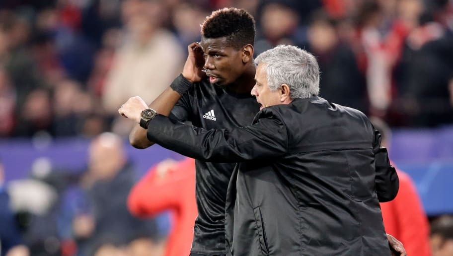 SEVILLA, SPAIN - FEBRUARY 21: (L-R) Paul Pogba of Manchester United, coach Jose Mourinho of Manchester United  during the UEFA Champions League  match between Sevilla v Manchester United at the Estadio Ramon Sanchez Pizjuan on February 21, 2018 in Sevilla Spain (Photo by Jeroen Meuwsen/Soccrates/Getty Images)