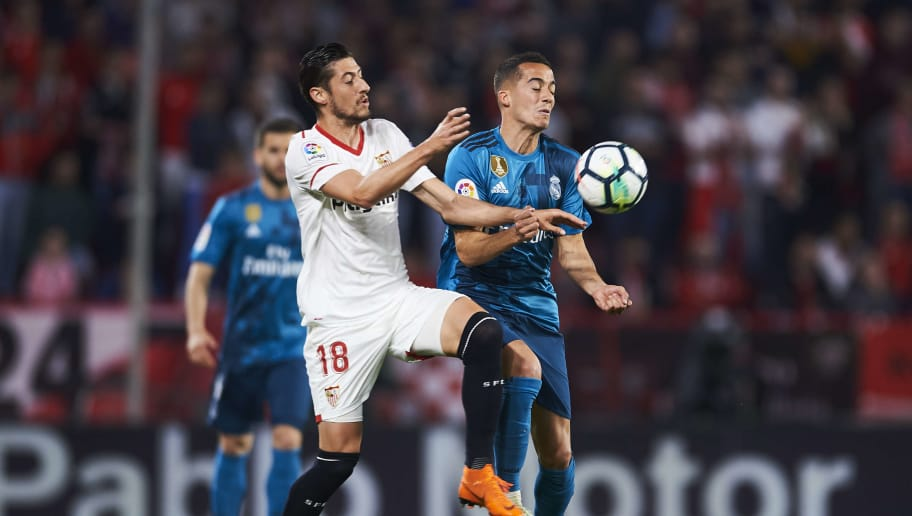 SEVILLE, SPAIN - MAY 09:  Lucas Vazquez of Real Madrid CF (R) competes for the ball with Sergio Escudero of Sevilla FC (L) during the La Liga match between Sevilla FC and Real Madrid at Ramon Sanchez Pizjuan stadium on May 9, 2018 in Seville, Spain.  (Photo by Aitor Alcalde/Getty Images)