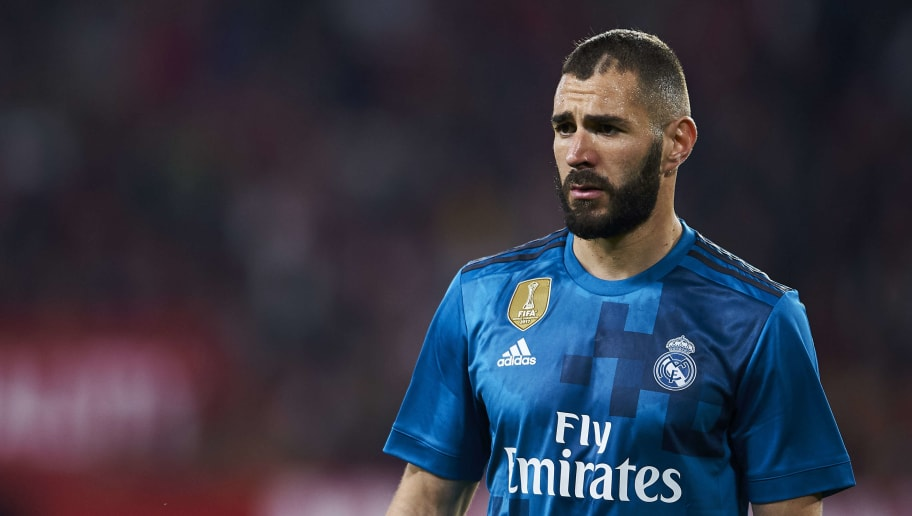 SEVILLE, SPAIN - MAY 09:  Karim Benzema of Real Madrid CF reacts during the La Liga match between Sevilla FC and Real Madrid at Ramon Sanchez Pizjuan stadium on May 9, 2018 in Seville, Spain.  (Photo by Aitor Alcalde/Getty Images)