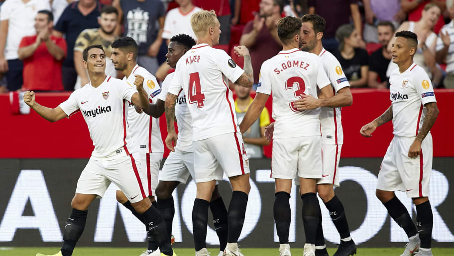 SEVILLE, SPAIN - SEPTEMBER 20:  Wissam Ben Yedder of Sevilla FC celebrates after scoring his side's third goal with his teammates during the UEFA Europa League Group J match between Sevilla and Royal Standard de Liege at Estadio Ramon Sanchez Pizjuan on September 20, 2018 in Seville, Spain.  (Photo by Quality Sport Images/Getty Images)