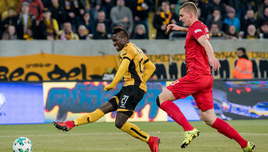 DRESDEN, GERMANY - MARCH 09: Moussa Kone (L) of Dresden scores his team's second goal past Kevin Kraus of Heidenheim during the Second Bundesliga match between SG Dynamo Dresden and 1. FC Heidenheim 1846 at DDV-Stadion on March 9, 2018 in Dresden, Germany. (Photo by Thomas Eisenhuth/Bongarts/Getty Images)