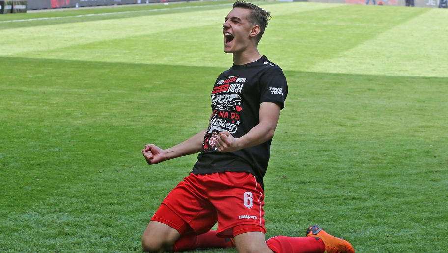 DRESDEN, GERMANY - APRIL 28:  Florian Neuhaus of Duesseldorf jubilates after moving up into the Bundesliga after the Second Bundesliga match between SG Dynamo Dresden and Fortuna Duesseldorf at DDV-Stadion on April 28, 2018 in Dresden, Germany.  (Photo by Matthias Kern/Bongarts/Getty Images)