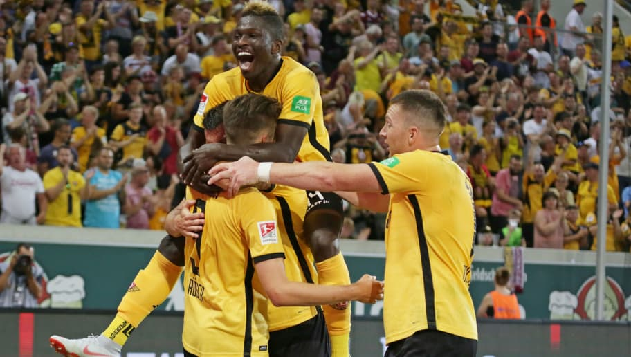 DRESDEN, GERMANY - AUGUST 06: Lucas Roeser of Dynamo Dresden celebrates after scoring his team`s first goal with team mates during the second Bundesliga match between SG Dynamo Dresden and MSV Duisburg on August 6, 2018 in Dresden, Germany. (Photo by TF-Images/Getty Images)