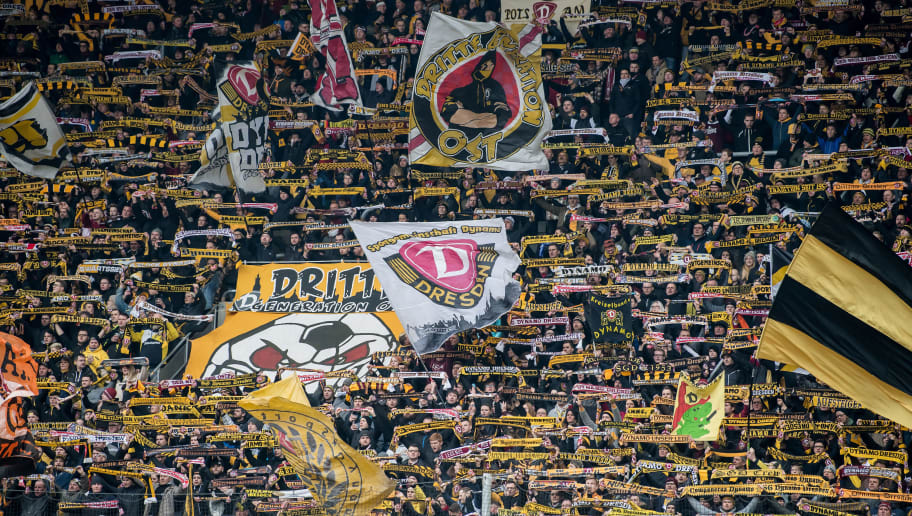 DRESDEN, GERMANY - FEBRUARY 18: Fans of Dynamo Dresden support the team during the Second Bundesliga match between SG Dynamo Dresden and SSV Jahn Regensburg at DDV-Stadion on February 18, 2018 in Dresden, Germany. (Photo by Thomas Eisenhuth/Bongarts/Getty Images)