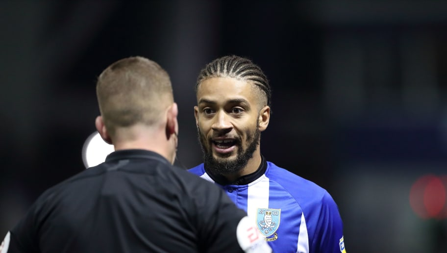 SHEFFIELD, ENGLAND - SEPTEMBER 28: Michael Hector of Sheffield Wednesday receives a talking to by Match referee Robert Jones during the Sky Bet Championship match between Sheffield Wednesday v Leeds United at Hillsborough Stadium on September 28, 2018 in Sheffield, England. (Photo by James Williamson - AMA/Getty Images)