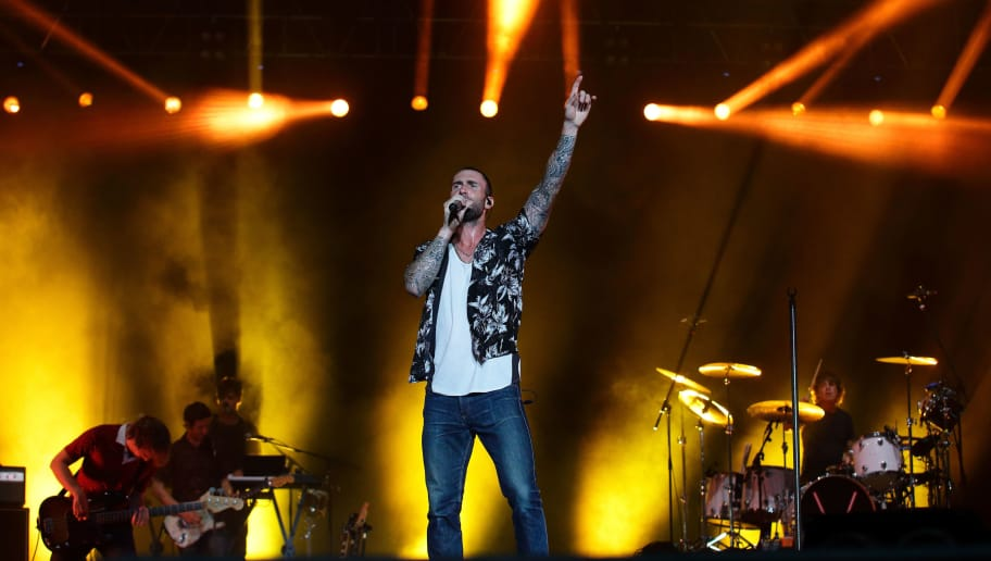 SINGAPORE - SEPTEMBER 19: Maroon 5 performs live on stage on Day 2 at the Singapore Formula One Grand Prix at Marina Bay Street Circuit on September 19, 2015 in Singapore.  (Photo by Suhaimi Abdullah/Getty Images)
