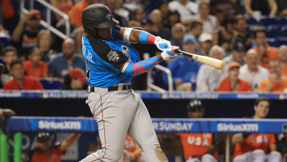 MIAMI, FL - JULY 09:  Vladimir Guerrero Jr. #27 of the Toronto Blue Jays and the World Team swings at a pitch against the U.S. Team during the SiriusXM All-Star Futures Game at Marlins Park on July 9, 2017 in Miami, Florida.  (Photo by Mike Ehrmann/Getty Images)