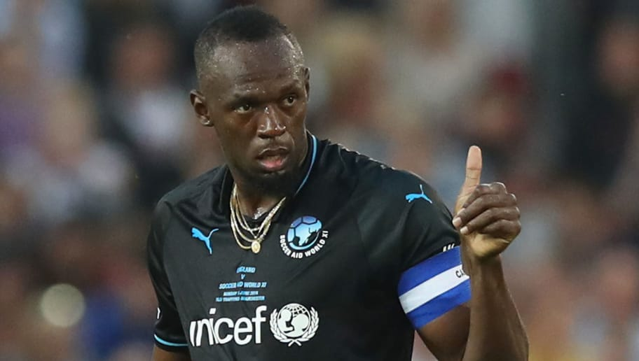 MANCHESTER, ENGLAND - JUNE 10:  Usain Bolt of the Rest of the World gives a thumbs up during the Soccer Aid for UNICEF 2018 match between Englannd and the Rest of the World at Old Trafford on June 10, 2018 in Manchester, England.  (Photo by Lynne Cameron/Getty Images)