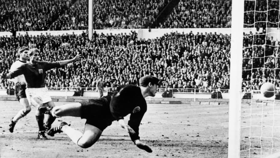 West Germany's goalkeeper Hans Tilkowski watches the ball bounce off the crossbar following a shot by English forward Geoff Hurst (not pictured) as English forward Roger Hunt (arms raised) and West Germany's defender Wolgang Weber look on during the overtime period of the World Cup final on July 30, 1966 at Wembley stadium in London.  After consulting Soviet linesman Tofik Bakhramov, Swiss referee Gottfried Dienst validated the goal as England went on to defeat West Germany 4-2, with Hurst scoring three goals, to win its first World Cup title. / AFP / CENTRAL PRESS / STF        (Photo credit should read STF/AFP/Getty Images)