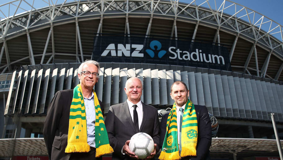 SYDNEY, AUSTRALIA - AUGUST 30:  (L-R) FFA CEO David Gallop, Socceroos Head Coach Graham Arnold and ANZ Stadium CEO Daryl Kerry pose after annoucing the Socceroos v Lebanon International friendly match at ANZ Stadium on August 30, 2018 in Sydney, Australia.  (Photo by Matt King/Getty Images)
