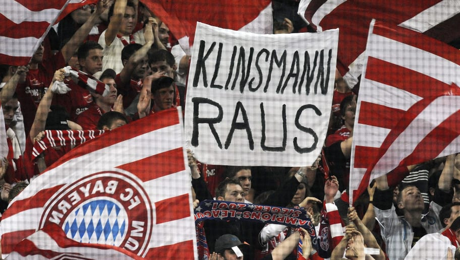 Some Bayern Munich supporters hold up a