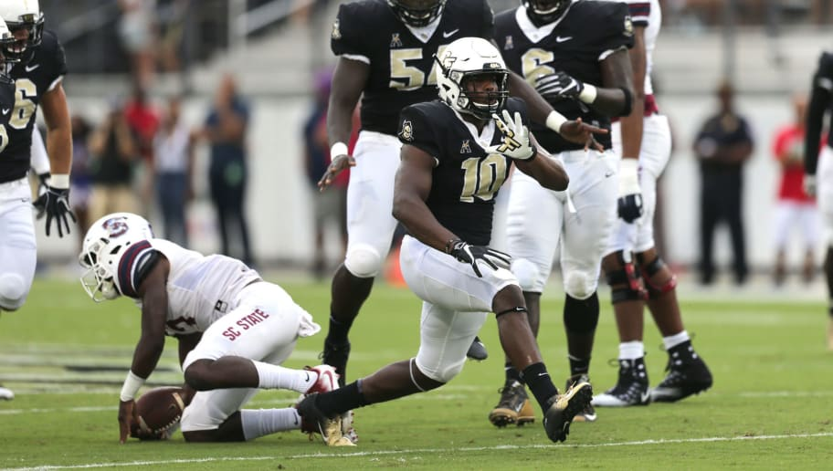ORLANDO, FL - SEPTEMBER 08:  Titus Davis #10 of the UCF Knights celebrates a tackle during a football game against the South Carolina State Bulldogs at Spectrum Stadium on September 8, 2018 in Orlando, Florida. (Photo by Alex Menendez/Getty Images)