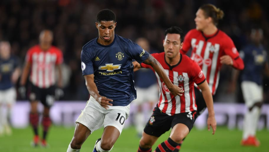 SOUTHAMPTON, ENGLAND - DECEMBER 01: Marcus Rashford of Manchester United gets past Maya Yoshida of Southampton during the Premier League match between Southampton FC and Manchester United at St Mary's Stadium on December 01, 2018 in Southampton, United Kingdom. (Photo by Mike Hewitt/Getty Images)