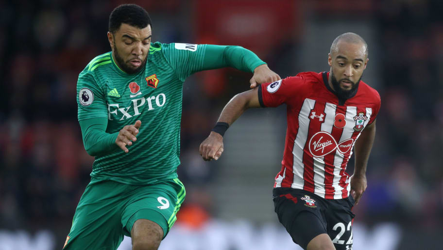 SOUTHAMPTON, ENGLAND - NOVEMBER 10:  Nathan Redmond of Southampton is challenged by Troy Deeney of Watford during the Premier League match between Southampton FC and Watford FC at St Mary's Stadium on November 10, 2018 in Southampton, United Kingdom.  (Photo by Bryn Lennon/Getty Images)