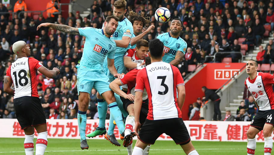 SOUTHAMPTON, ENGLAND - APRIL 28:  Simon Francis and Nathan Ake of AFC Bournemouth  compete for a header with Jan Bednarek of Southampton during the Premier League match between Southampton and AFC Bournemouth at St Mary's Stadium on April 28, 2018 in Southampton, England.  (Photo by Mike Hewitt/Getty Images)