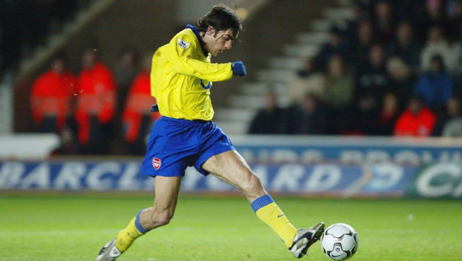 SOUTHAMPTON, ENGLAND - DECEMBER 29:  Robert Pires of Arsenal scores the first goal during the FA Barclaycard Premiership match between Southampton and Arsenal at St Mary's Stadium  on December 29, 2003, in Southampton, England.  (Photo by Mike Hewitt/Getty Images)