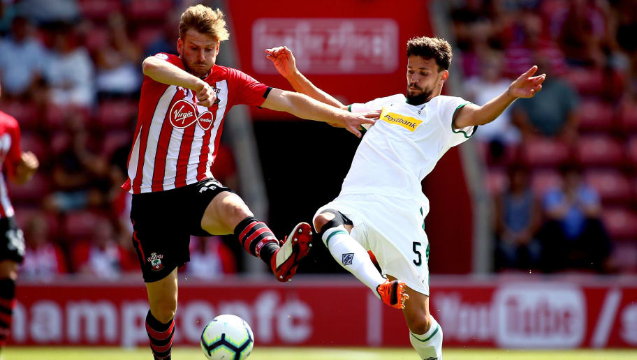 SOUTHAMPTON, ENGLAND - AUGUST 04:  Stuart Armstrong of Southampton tackles with Tobias Strobl of Borussia Monchengladbach during the pre-season friendly match between Southampton and Borussia Monchengladbach at St Mary's Stadium on August 4, 2018 in Southampton, England.  (Photo by Jordan Mansfield/Getty Images)