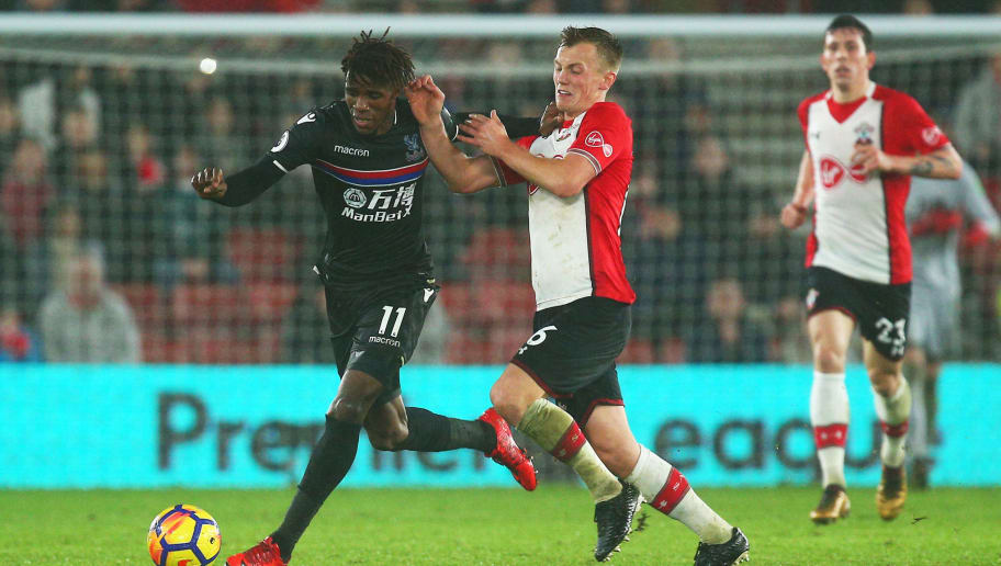 SOUTHAMPTON, ENGLAND - JANUARY 02: Wilfried Zaha of Crystal Palace is challenged by James Ward-Prowse of Southampton during the Premier League match between Southampton and Crystal Palace at St Mary's Stadium on January 2, 2018 in Southampton, England.  (Photo by Charlie Crowhurst/Getty Images)