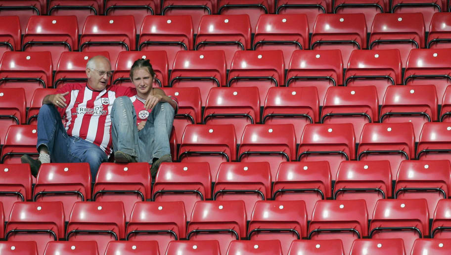 SOUTHAMPTON, ENGLAND - MAY 15: Two dejected Southampton fans at the end of the Barclays Premiership match between Southampton and Manchester United on May 15, 2005 at the St. Mary's Stadium in Southampton, England. (Photo by Mike Hewitt/Getty Images)