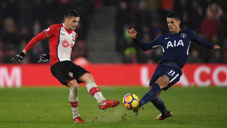 SOUTHAMPTON, ENGLAND - JANUARY 21:  Dusan Tadic of Southampton is challenged by Erik Lamela of Tottenham Hotspur during the Premier League match between Southampton and Tottenham Hotspur at St Mary's Stadium on January 21, 2018 in Southampton, England.  (Photo by Mike Hewitt/Getty Images)