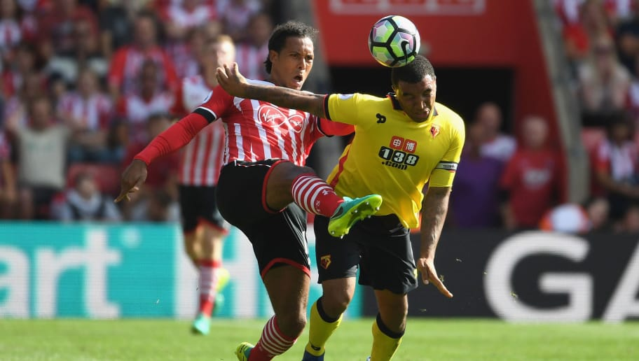 SOUTHAMPTON, ENGLAND - AUGUST 13: Virgil van Dijk of Southampton battle for possession with Troy Deeney of Watford during the Premier League match between Southampton and Watford at St Mary's Stadium on August 13, 2016 in Southampton, England.  (Photo by Mike Hewitt/Getty Images)