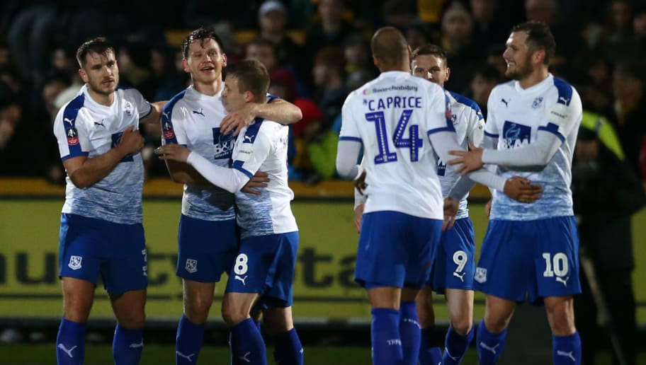 SOUTHPORT, ENGLAND - DECEMBER 17:  Connor Jennings of Tranmere celebrates with teammates after scoring his sides second goal during the FA Cup Second Round Replay match between Southport and Tranmere Rovers at Haig Avenue on December 17, 2018 in Southport, England.  (Photo by Jan Kruger/Getty Images)