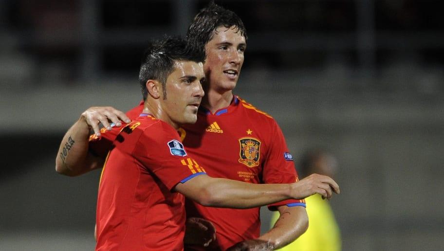 Spain's forward David Villa (L) celebrat
