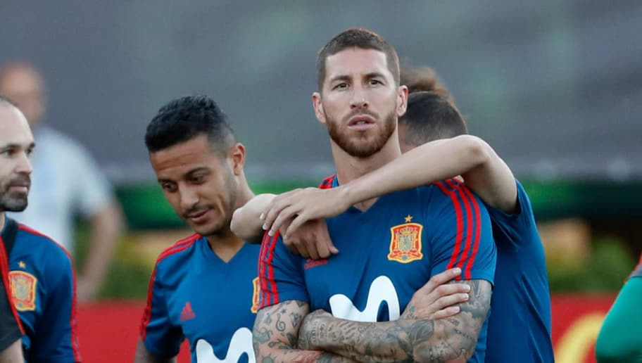 KRASNODAR, RUSSIA - JUNE 13: Sergio Ramos of Spain looks on and Jordi Alba of Spain hugs him during a training session on June 13, 2018 in Krasnodar, Russia. (Photo by TF-Images/Getty Images)