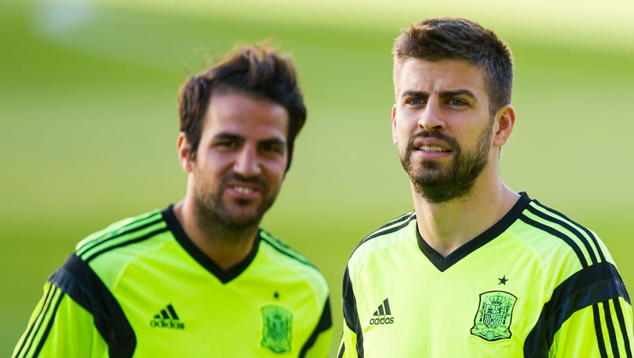 SEVILLE, SPAIN - MAY 29:  Cesc Fabregas (L) and Gerard Pique of Spain look on during a training session ahead of their international friendly match against Bolivia at the Ramon Sanchez Pizjuan stadium on May 29, 2014 in Seville, Spain.  (Photo by David Ramos/Getty Images)