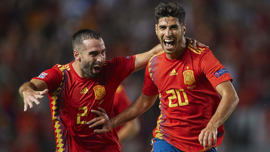 ALICANTE, SPAIN - SEPTEMBER 11:  Marco Asensio (R) of Spain celebrates after scoring his sides third goal with his teammate Dani Carvajal during the UEFA Nations League A group four match between Spain and Croatia at Manuel Martinez Valero Stadium on September 11, 2018 in Alicante, Spain.  (Photo by Quality Sport Images/Getty Images)