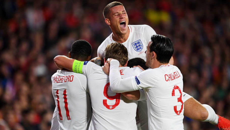 SEVILLE, SPAIN - OCTOBER 15:  Ross Barkley of England (top) celebrates with team mates as as Raheem Sterling of England (obscured) scores his team's first goal during the UEFA Nations League A Group Four match between Spain and England at Estadio Benito Villamarin on October 15, 2018 in Seville, Spain.  (Photo by Michael Regan/Getty Images)