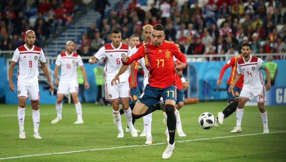 KALININGRAD, RUSSIA - JUNE 25:  Iago Aspas of Spain back heels in past Monir El Kajoui of Morocco to score his sides second goal during the 2018 FIFA World Cup Russia group B match between Spain and Morocco at Kaliningrad Stadium on June 25, 2018 in Kaliningrad, Russia.  (Photo by Julian Finney/Getty Images)
