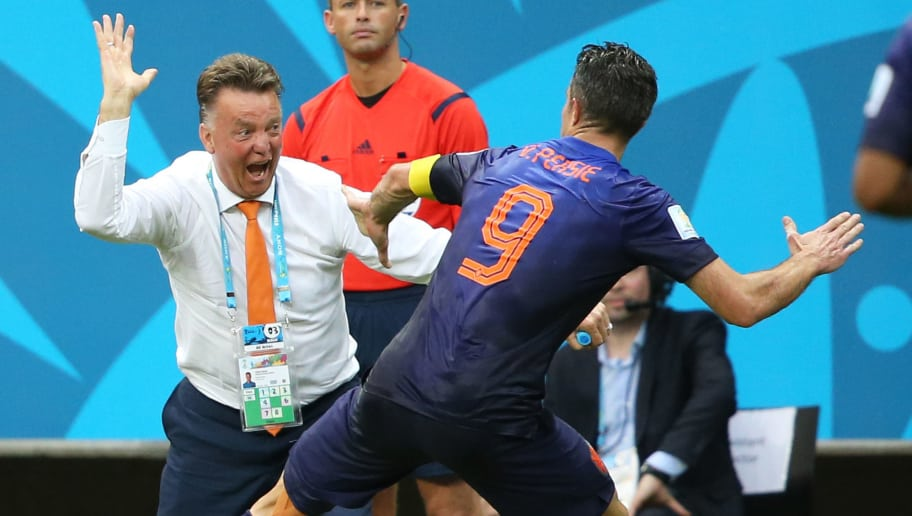 SALVADOR, BRAZIL - JUNE 13:  Head coach of the Netherlands Louis Van Gaal celebrates the first goal with his player Robin Van Persie of the Netherlands during the 2014 FIFA World Cup Brazil Group B match between Spain and Netherlands at Arena Fonte Nova on June 13, 2014 in Salvador, Brazil. (Photo by Jean Catuffe/Getty Images)