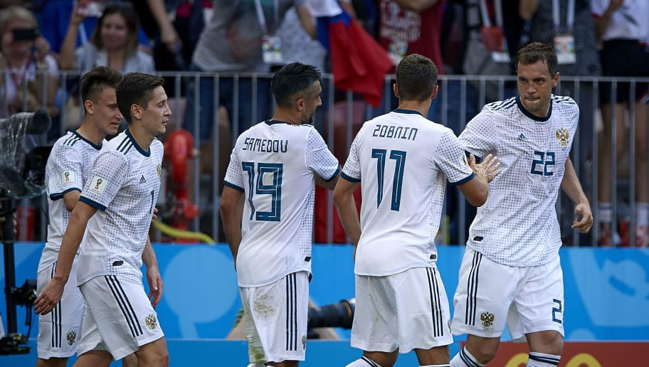 MOSCOW, RUSSIA - JULY 01:  Artem Dzyuba (R) of Russia celebrates with his teammates after scoring a goal during the 2018 FIFA World Cup Russia Round of 16 match between Spain and Russia at Luzhniki Stadium on July 1, 2018 in Moscow, Russia.  (Photo by Quality Sport Images/Getty Images)