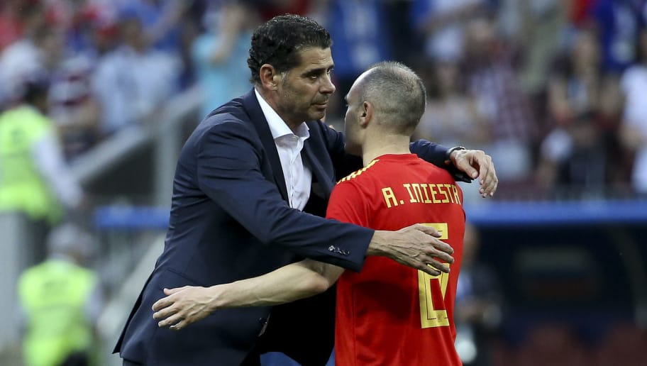 MOSCOW, RUSSIA - JULY 1: Coach of Spain Fernando Hierro, Andres Iniesta dejected following the 2018 FIFA World Cup Russia Round of 16 match between Spain and Russia at Luzhniki Stadium on July 1, 2018 in Moscow, Russia. (Photo by Jean Catuffe/Getty Images)