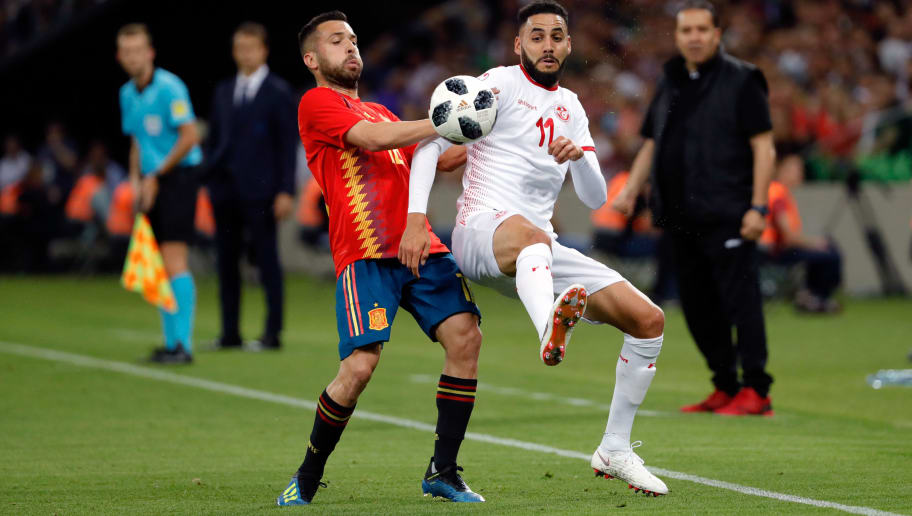KRASNODAR, RUSSIA - JUNE 09: Jordi Alba of Spain and Dylan Bronn of Tunisia battle for the ball during the friendly match between Spain and Tunisia at Krasnodar's stadium on June 9, 2018 in Krasnodar, Russia. (Photo by TF-Images/Getty Images)
