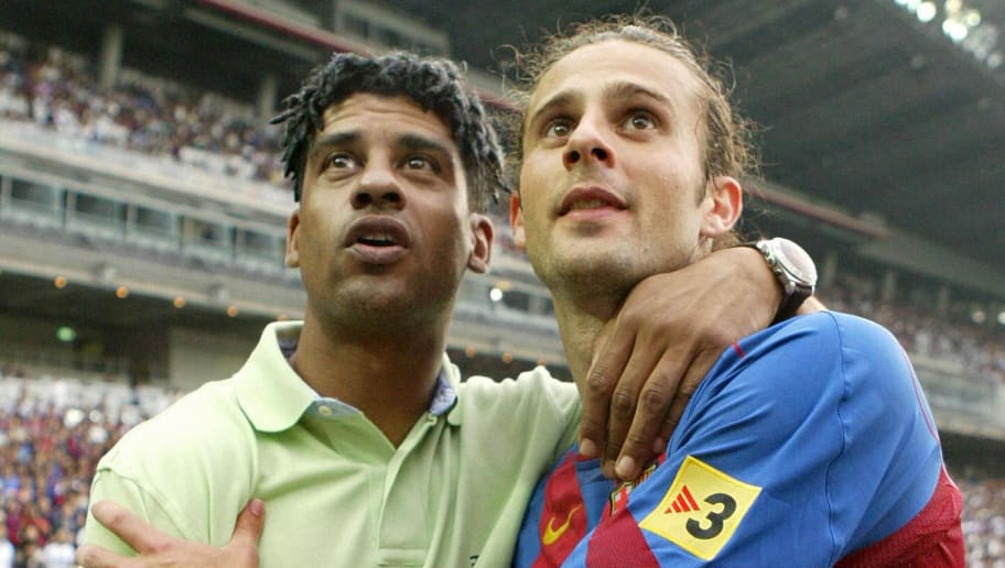YOKOHAMA, JAPAN:  Spanish FC Barcelona head coach Frank Rijkaard (L) of Netherlands stands with most valuable player of the match, Thiago Motta of Brazil, after an international friendly against Japan's Yokohama F. Marinos at the Nissan Stadium in Yokohama, Kanagawa Prefecture, 12 June 2005.  The match was tied at 3 to 3.   AFP PHOTO/Kazuhiro NOGI  (Photo credit should read KAZUHIRO NOGI/AFP/Getty Images)