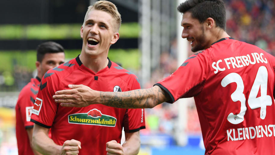 FREIBURG IM BREISGAU, GERMANY - APRIL 28: Nils Petersen of Freiburg (c) celebrates with Tim Kleindienst of Freiburg (r) after he scored a goal to make it 2:0 during the Bundesliga match between Sport-Club Freiburg and 1. FC Koeln at Schwarzwald-Stadion on April 28, 2018 in Freiburg im Breisgau, Germany. (Photo by Matthias Hangst/Bongarts/Getty Images)