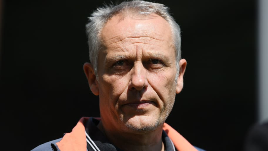 FREIBURG IM BREISGAU, GERMANY - APRIL 28: Coach Christian Streich of Freiburg looks on before the Bundesliga match between Sport-Club Freiburg and 1. FC Koeln at Schwarzwald-Stadion on April 28, 2018 in Freiburg im Breisgau, Germany. (Photo by Matthias Hangst/Bongarts/Getty Images)