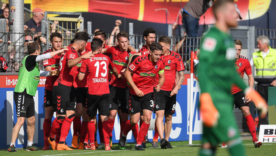 FREIBURG IM BREISGAU, GERMANY - APRIL 28: Lucas Hoeler of Freiburg (9) is celebrated by his team after he scored a goal to make it 3:2 during the Bundesliga match between Sport-Club Freiburg and 1. FC Koeln at Schwarzwald-Stadion on April 28, 2018 in Freiburg im Breisgau, Germany. (Photo by Matthias Hangst/Bongarts/Getty Images)