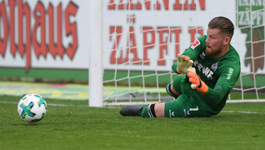 FREIBURG IM BREISGAU, GERMANY - APRIL 28: Timo Horn of Koeln saves a penalty by Christian Guenter of Freiburg (not seen) during the Bundesliga match between Sport-Club Freiburg and 1. FC Koeln at Schwarzwald-Stadion on April 28, 2018 in Freiburg im Breisgau, Germany. (Photo by Matthias Hangst/Bongarts/Getty Images)