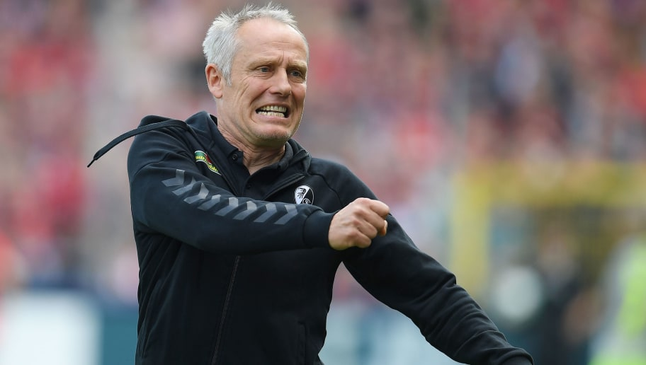 FREIBURG IM BREISGAU, GERMANY - APRIL 28: Coach Christian Streich of Freiburg reacts during the Bundesliga match between Sport-Club Freiburg and 1. FC Koeln at Schwarzwald-Stadion on April 28, 2018 in Freiburg im Breisgau, Germany. (Photo by Matthias Hangst/Bongarts/Getty Images)