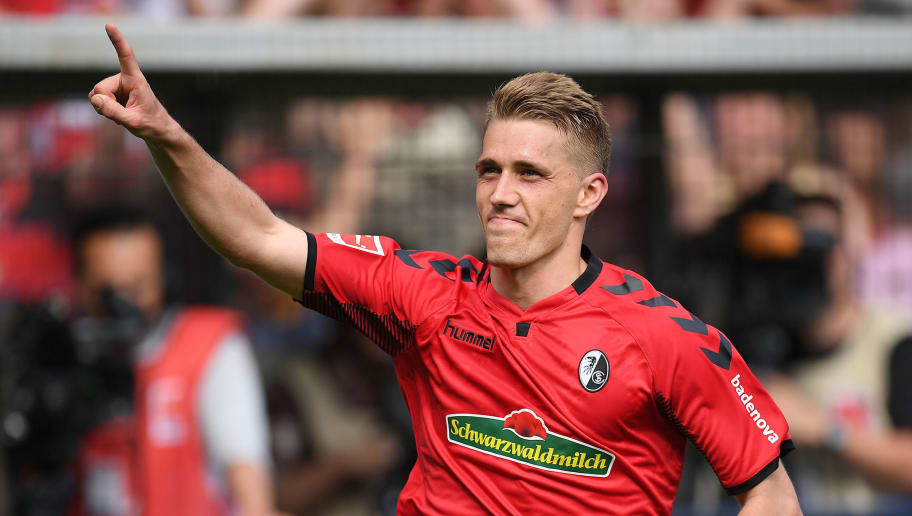 FREIBURG IM BREISGAU, GERMANY - APRIL 28: Nils Petersen of Freiburg celebrates after he scored a goal to make it 2:0 during the Bundesliga match between Sport-Club Freiburg and 1. FC Koeln at Schwarzwald-Stadion on April 28, 2018 in Freiburg im Breisgau, Germany. (Photo by Matthias Hangst/Bongarts/Getty Images)