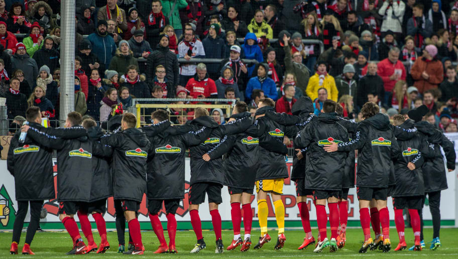 FREIBURG IM BREISGAU, GERMANY - NOVEMBER 25: Team SC Freiburg celebrates their win with fans after the Bundesliga match between Sport-Club Freiburg and 1. FSV Mainz 05 at Schwarzwald-Stadion on November 25, 2017 in Freiburg im Breisgau, Germany. (Photo by Robert Hradil/Bongarts/Getty Images)