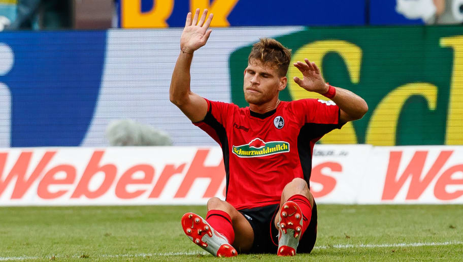 FREIBURG IM BREISGAU, GERMANY - AUGUST 25: Florian Niederlechner of Sport-Club Freiburg am Boden gestures during the Bundesliga match between Sport-Club Freiburg and Eintracht Frankfurt at Schwarzwald-Stadion on August 25, 2018 in Freiburg im Breisgau, Germany. (Photo by TF-Images/Getty Images)